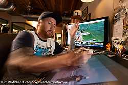 Roland doing design work on his computer drawing tablet in his office at his Roland Sands Design (RSD) retail and office location, Los Alamitos, CA. Monday June 25, 2018. Photography ©2018 Michael Lichter.