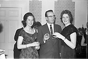 17/12/1962<br /> 12/17/1962<br /> 17 December 1962<br /> A.E.I. Gala reception at Shangri-la Hotel, Dalkey, Dublin, where a Gala Supermatic washing machine was presented to the Variety Club of Ireland for their Easter Draw by Gala. Pictured at the event are: Miss Gertie O'Malley (Dorothy Gray Ltd., Consultant); Mr. Jack Cruise, (Variety Club of Ireland) and Miss Annette Vahey, (A.E.I. Gala Demonstrator).
