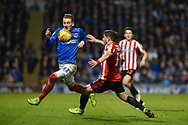 Portsmouth Midfielder, Ronan Curtis (11) gets to the ball first during the EFL Sky Bet League 1 match between Portsmouth and Sunderland at Fratton Park, Portsmouth, England on 22 December 2018.