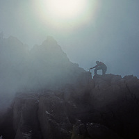 A mountaineer approaches the summit of Mount Humphreys on the crest of California's Sierra Nevada.