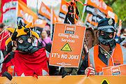 Protestors in 'gas masks' point the finger at toxic Tories. Britain needs a pay rise - A march organised by the TUC to demand fairer and pay rises for the lowest paid and particularly in the public sector. The march started at Embankment, passed through Trafalgar Square and ended with speeches in Hyde Park.