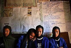 Four married or engaged Muslim school girls sit together in the school office in Merawi Village near Bahir Dar, Ethiopia on May 22, 2007. Age-old traditions, such as early marriage, which is a common phenomenon in much of the country, reinforce attitudes that decry the need to send girls to school. Most married girls, who would like to continue their schooling, are often prevented from doing so. These girls are lucky. High levels of adult illiteracy rates, with only one in four adults in rural areas able to read and write, and often abject poverty exacerbate the situation.