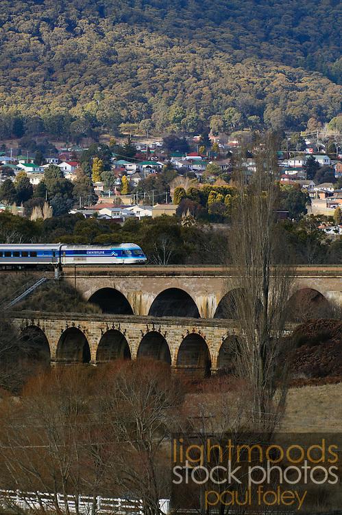 Countrylink Train crossing old stone bridge near Lithgow, NSW,Australia