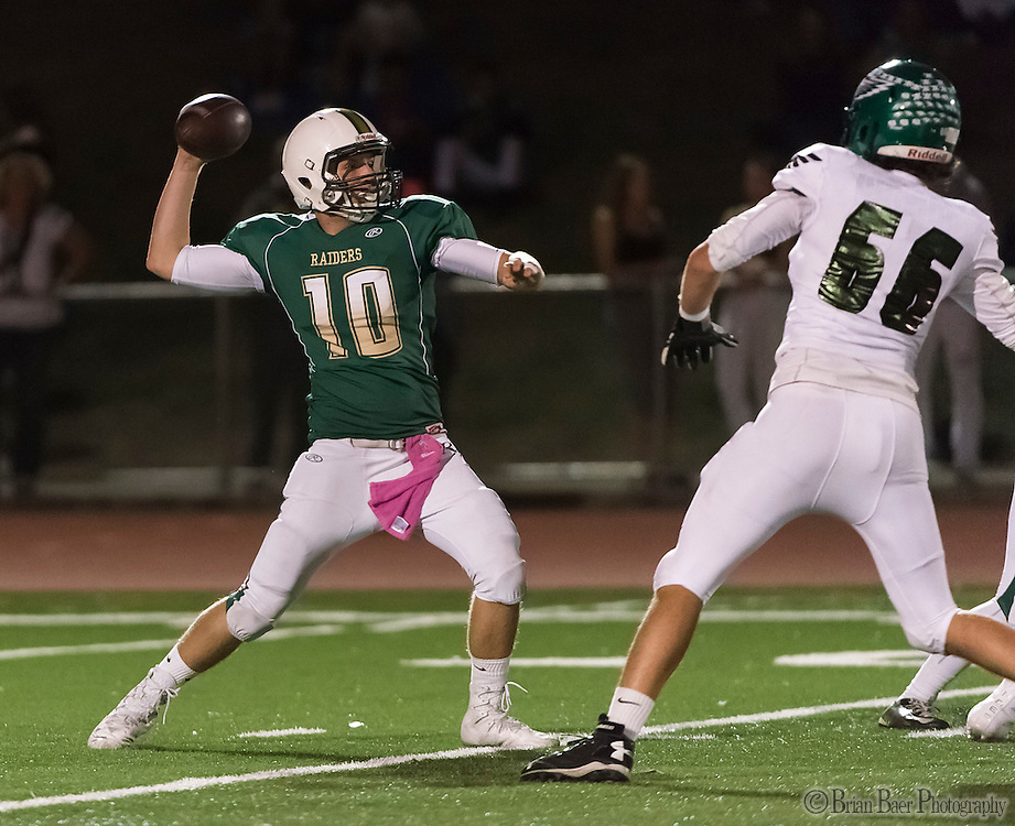 Rio Americano Raiders Sam Adams (10), passes the ball during the first quarter as the El Camino Eagles host the Rio Americano Raiders at Del Campo High School, Friday Oct 7, 2016. <br /> photo by Brian Baer
