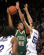 William & Mary forward Corey Cofield (45) goes up for a shot over Kansas State center Jason Bennett (55) in the first half at Bramlage Coliseum in Manhattan, Kansas, November 11, 2006.  K-State defeated the Tribe 70-60.<br />