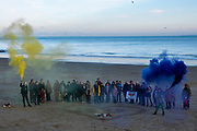 Local residents of the Kent seaside town of Folkestone with flares gather around a heart with the figure 39 in it on Sunny Sands Beach, Folkestone, Kent, UK. The vigil was organised by locals to remember the 39 people discovered in Essex from Vietnam who perished in the back of a truck while being trafficked into the UK inside a refrigerated container. (Image © Andy Aitchison)<br /> (photo by Andrew Aitchison / In pictures via Getty Images)