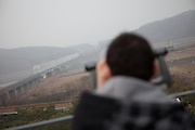 """Imjingak/South Korea, Republic Korea, KOR, 28.11.2009: Tourists watching at the  so called """"Bridge of Freedom"""" at Imjingak, located 7 km from the Military Demarcation Line, which is now at the forefront of tourism related to the Korean Conflict. It was built in 1972 with the hope that someday unification would be possible."""