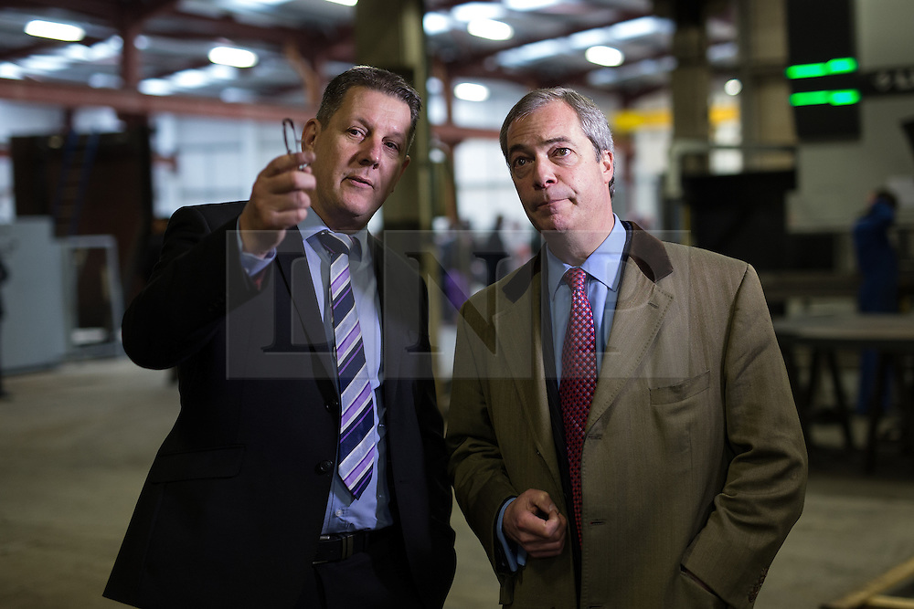 © Licensed to London News Pictures . 23/03/2015 . Middleton , UK . Nigel Farage being shown around by general manager Dean Barnard . UKIP leader Nigel Farage , Deputy Leader Paul Nuttall and Economics Spokesman Patrick O'Flynn announce UKIP's economic policy at Concept Metal Products and Co Ltd in Middleton , Lancashire . Photo credit : Joel Goodman/LNP