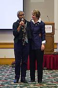 Rockwood Leadership Program President Akaya Windwood, left, and SEIU International President Mary Kay Henry stand together during the Service Employees International Union BOLD Retreat at Dolce Hayes Mansion in San Jose, California, on November 21, 2013. (Stan Olszewski/SOSKIphoto)