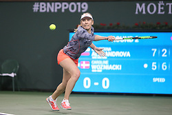 March 9, 2019 - Indian Wells, CA, U.S. - INDIAN WELLS, CA - MARCH 09: Ekaterina Alexandrova (RUS) stretches to hit a backhand during the BNP Paribas Open on March 9, 2019 at Indian Wells Tennis Garden in Indian Wells, CA. (Photo by George Walker/Icon Sportswire) (Credit Image: © George Walker/Icon SMI via ZUMA Press)