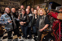 Sante Mazza (2nd from L) and Claudia Ganzaroli (R) with fellow members of the Motociclette Americane Club of Rimini in their booth at Motor Bike Expo. Verona, Italy. Sunday January 22, 2017. Photography ©2017 Michael Lichter.