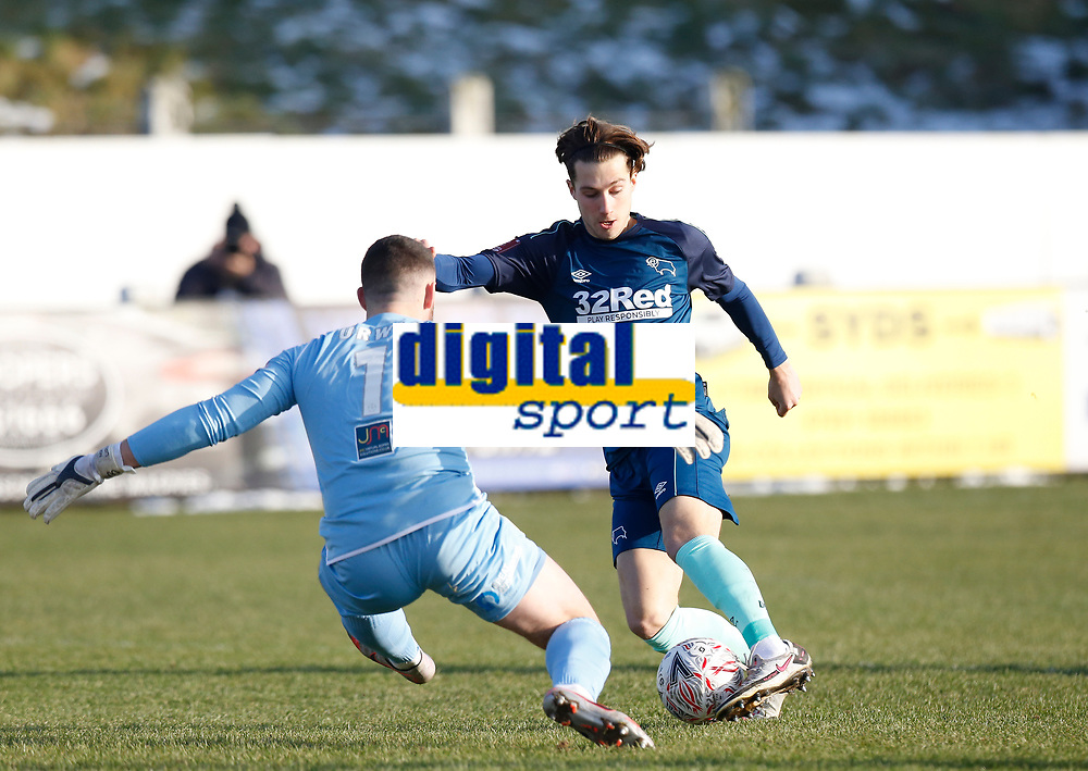 Football - 2020 / 2021 Emirates FA Cup - Round Three: Chorley vs. Derby County<br /> <br /> Derby County's Cameron Cresswell attempts to go around Chorley keeper Matt Urwin but is brought down, at Victory Park.<br /> <br /> COLORSPORT/ALAN MARTIN