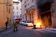 Firefighters put out a fire in Perpignan after a suspected arson attack setting alight to a old sofa in the street. Perpignan, France.