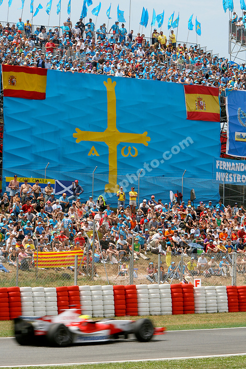 A blurred Ralf Schumacher (Toyota) passes an enormous Alonso flag in practice for the 2006 Spanish Grand Prix at the Circuit de Catalunya outside Bardelona. Photo: Grand Prix Photo