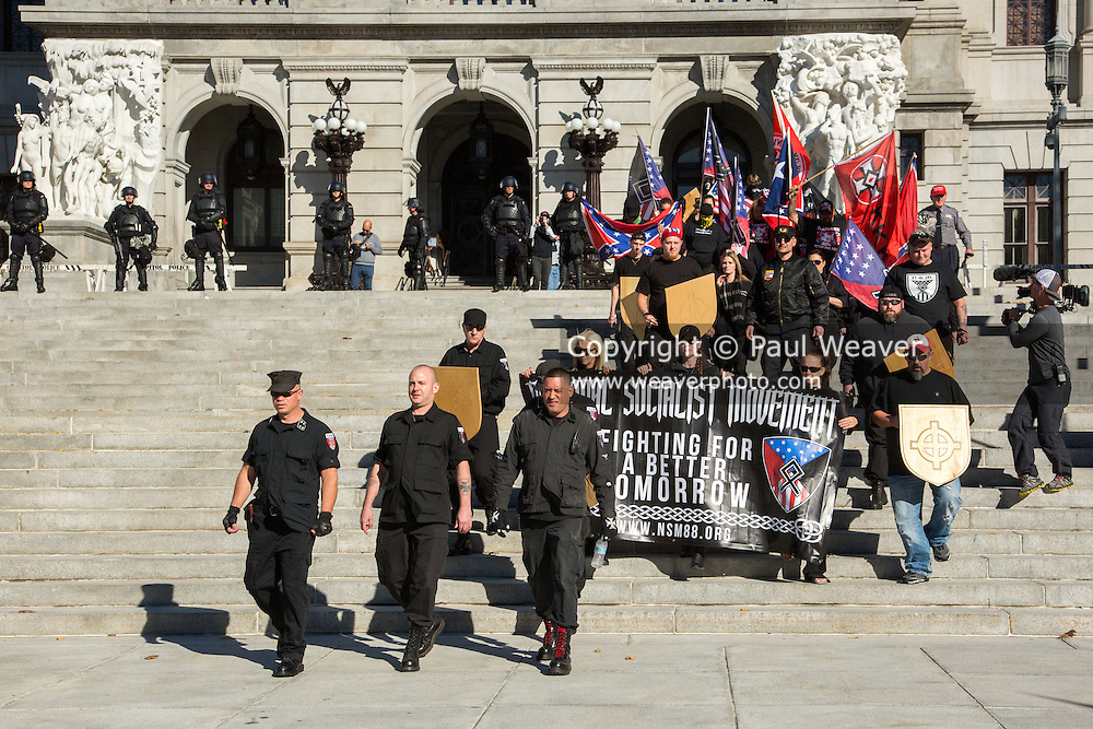 Harrisburg, PA (November 5, 2016) -- The National Socialist Movement held its Fall Political Rally on the steps of the Pennsylvania State Capitol. The approximately 40 participants were met by about 200 protesters. The two groups were separated by Pennsylvania State Police and Capitol Police, some in riot gear and some on horseback.