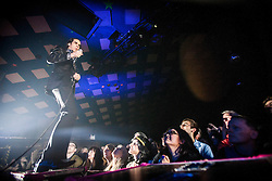 A wide angle shot of the frontman Nick Cave at the front of the crowd, Nick Cave and the Bad Seeds, on stage tonight at The Barrowlands, Glasgow, Scotland.<br /> ©Michael Schofield.