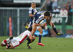 Jaque Fourie of the Stormers is tackled by James Slipper of the Reds during the Super Rugby (Super 15) fixture between DHL Stormers and the Reds played at DHL Newlands in Cape Town, South Africa on 9 April 2011. Photo by Jacques Rossouw/SPORTZPICS