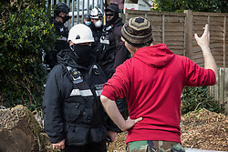 Sipson, UK. 8th March, 2021. Bailiffs from the National Eviction Team (NET) evict a resident from the remaining section of a squatted off-grid eco-community garden known as Grow Heathrow. Grow Heathrow was founded in 2010 on a previously derelict site close to Heathrow airport in protest against government plans for a third runway and has since made a significant educational and spiritual contribution to life in the Heathrow villages which are threatened by airport expansion.