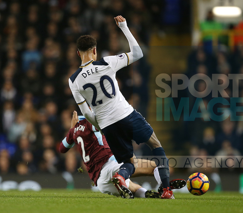 Tottenham's Dele Alli gets caught and injures his foot by Burnley's Matthew Lowton during the Premier League match at White Hart Lane Stadium, London. Picture date December 18th, 2016 Pic David Klein/Sportimage