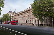Nearly empty buses travelling along a deserted Whitehall during the coronavirus pandemic on the 10th May 2020 in London, United Kingdom.