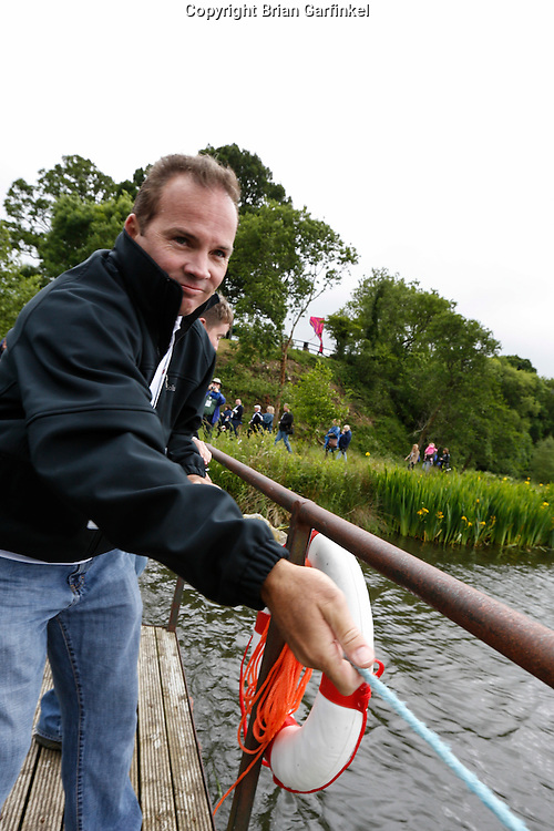 Rob Caulfield pulls a float across the water during a treasure hunt at the Caulfield/Mulryan family reunion at Ardenode Stud, County Kildare, Ireland on Sunday, June 23rd 2013. (Photo by Brian Garfinkel)