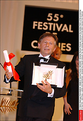 © Hahn-Nebinger-Petit/ABACA. 35045-8. Cannes-France, 26/5/2002. Director Roman Polanski is presented with the Golden Palm at the closing ceremony of the 55th Cannes Film Festival.