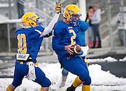 San Juan quarterback Barkley Christensen (2) reacts to scoring a touchdown during the first half of the Utah High School 2A Football championship game between San Juan and Manti, Saturday, Nov. 10, 2012.