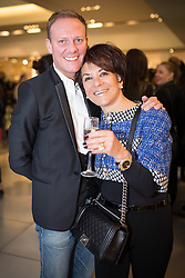 © Licensed to London News Pictures . 10/10/2013 .Manchester , UK . Actor Antony Cotton with friend Liz Taylor (correct) . Vogue Fashions Night Out in Selfridges , Exchange Square , Manchester City Centre . Photo credit : Joel Goodman/LNP