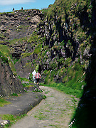 Two walkers take a stroll down a path leading to Beenbawn Strand in Dingle, County Kerry..Picture by Don MacMonagle
