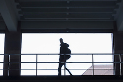 Silhouette of young student walking in a hallway, Freiburg im Breisgau, Baden-Wuerttemberg, Germany