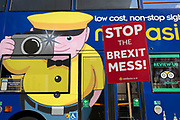 A pro-EU 'Stop This Brexit Mess' placard and a passing London tour bus during the continuing protest against Brexit, on 19th February 2019, in London, England.