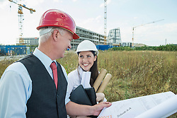 Architect and customer discussing construction plans