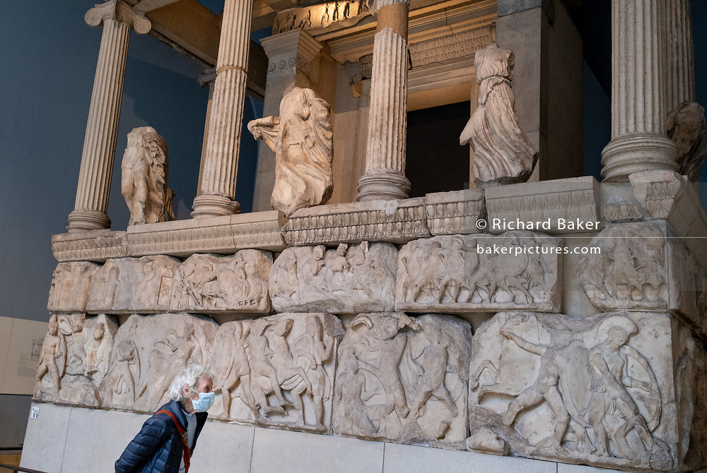 Now re-opened after months of closure during the Coronavirus pandemic, one of the first visitors who have pre-booked free tickets, once again enjoy the Elgin Marbles and other historical artifacts in the British Museum, on 2nd September 2020, in London, England.