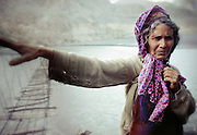 An old Wakhi woman after crossing a suspended bridge over the Hunza river in Gojal region, near Hunza, Northern Pakistan.