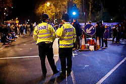 © Licensed to London News Pictures. 01/01/2016. London, UK. Police officers patrolling before the Mayor of London's New Year firework display in Westminster, London on January 1, 2016. Photo credit: Tolga Akmen/LNP