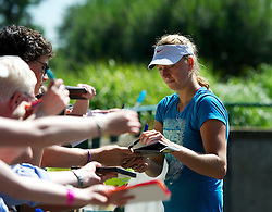 26.06.2012, Wimbledon, London, GBR, WTA, The Championships Wimbledon, im Bild Petra Kvitova (CZE) signs autoigraphs after practice during day two of the WTA Tour Wimbledon Lawn Tennis Championships at the All England Lawn Tennis and Croquet Club, London, Great Britain on 2012/06/26. EXPA Pictures © 2012, PhotoCredit: EXPA/ Propagandaphoto/ David Rawcliff..***** ATTENTION - OUT OF ENG, GBR, UK *****