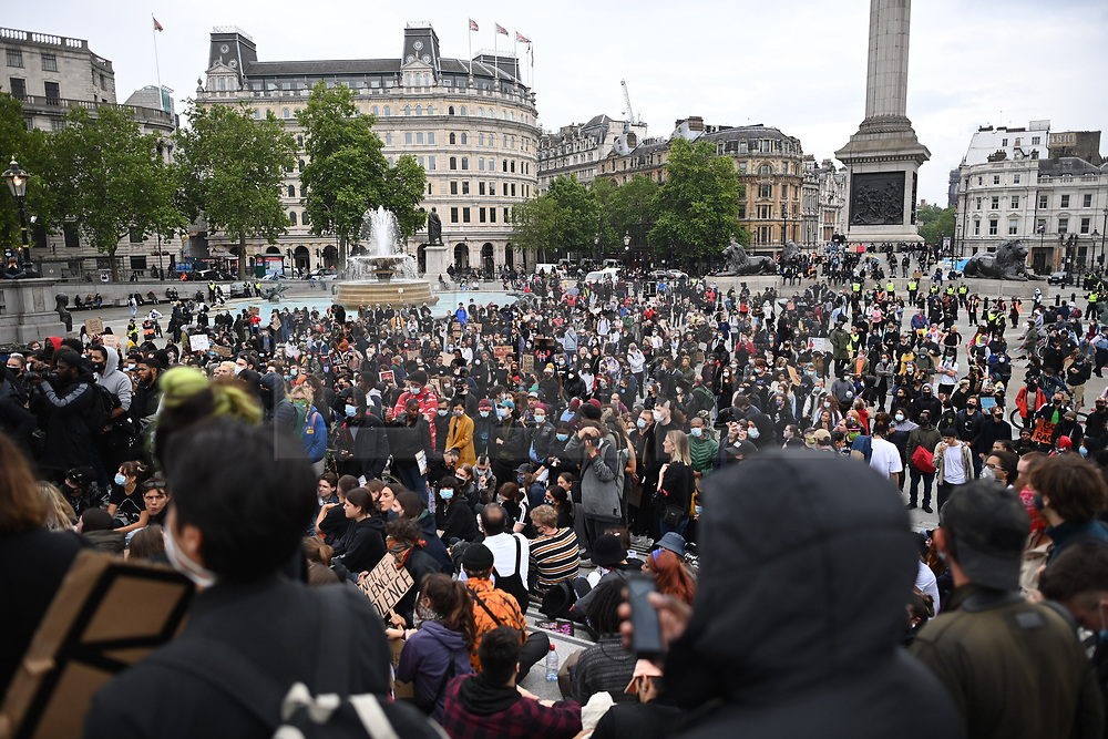 © Licensed to London News Pictures. 12/06/2020. London, UK. Protestors on Trafalgar Square during a Black Lives Matter demonstration In central London. Black Lives Matter have called for the removal of statues from throughout the UK of historical characters involved in the slave trade, following the death of George Floyd in the U. S. A. Photo credit: Ben Cawthra/LNP