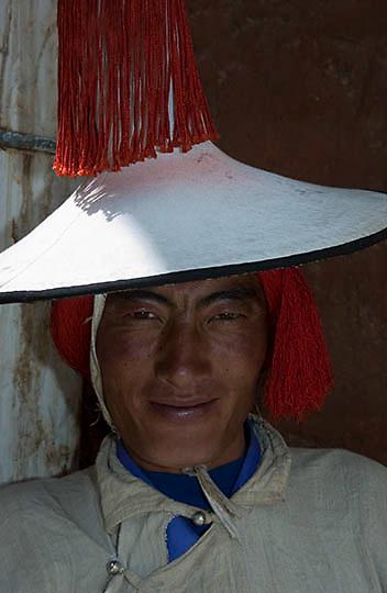 Local mountain village dress in traditional clothing (Drolma channel folk customs) Tibet. Asia.