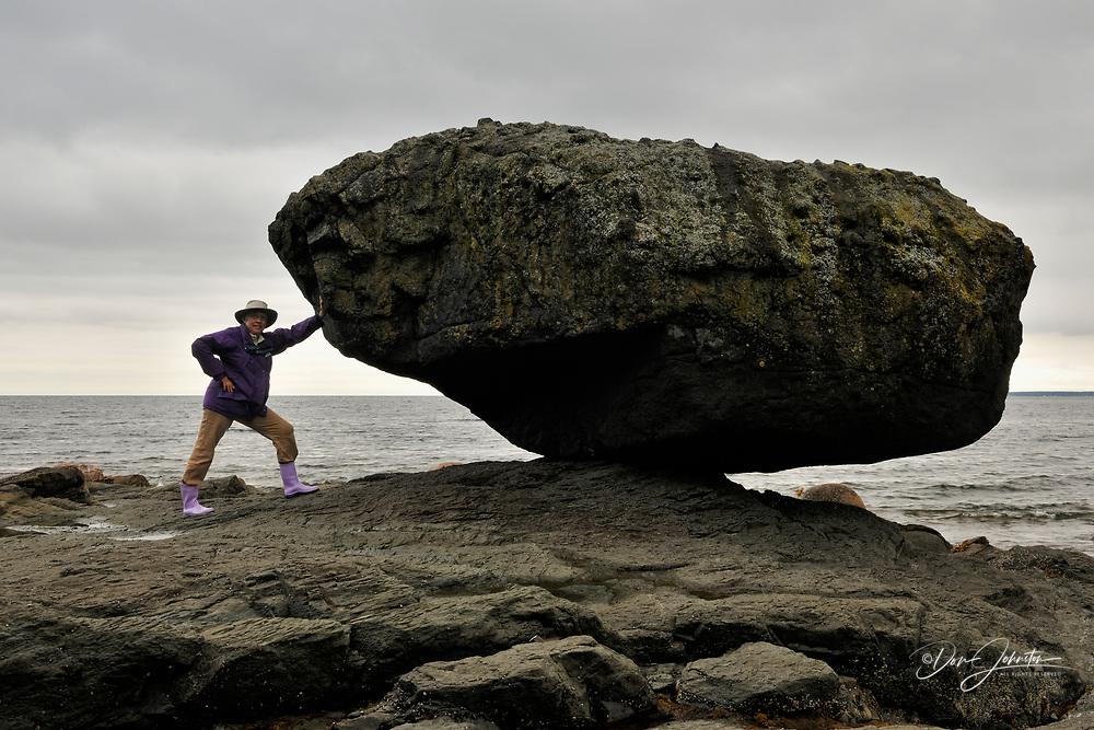 Balance Rock at low tide, with tourist, Haida Gwaii (Queen Charlotte Islands)- Skidegate, British Columbia, Canada