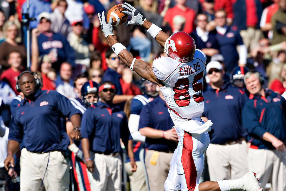OXFORD, MS - OCTOBER 24:   Greg Childs #85 of the Arkansas Razorbacks makes a catch in front of the Ole Miss Rebels bench at Vaught-Hemingway Stadium on October 24, 2009 in Oxford, Mississippi.  The Rebels defeated the Razorbacks 30 to 17.  (Photo by Wesley Hitt/Getty Images) *** Local Caption *** Greg Childs