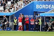 Chris Coleman, the Wales football team manager gives his instructions to Hal Robson-Kanu of Wales as he sends him on as a replacement in the 2nd half. Euro 2016, Wales v Slovakia at Matmut Atlantique , Nouveau Stade de Bordeaux  in Bordeaux, France on Saturday 11th June 2016, pic by  Andrew Orchard, Andrew Orchard sports photography.