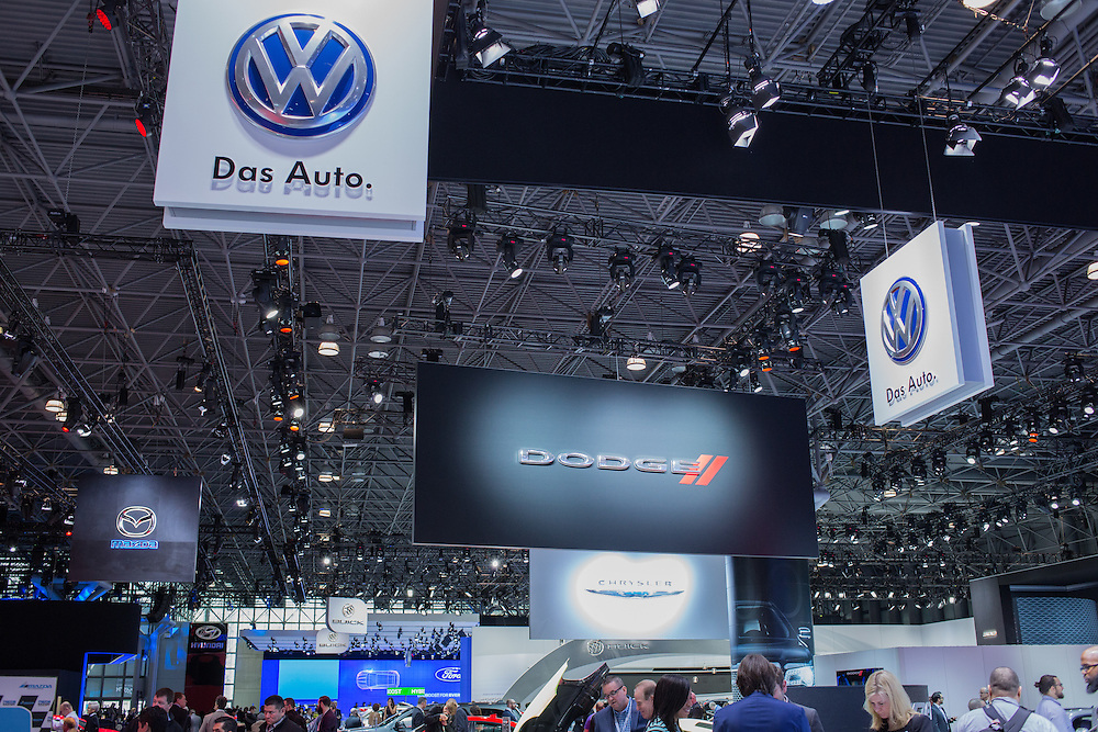 New York, NY - 1 April 2015. Signs from Volkswagen, Dodge, Mazda, Chrysler, Buick and Ford hang from the ceiling at the New York International Auto Show.