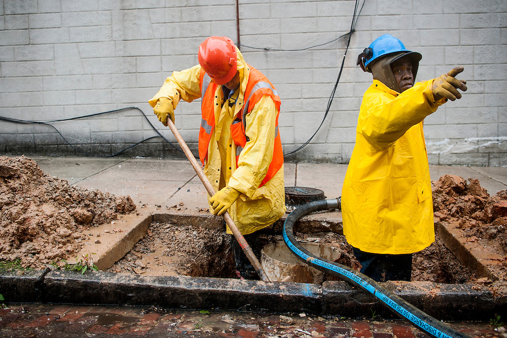 Photo by Matt Roth<br /> <br /> Baltimore City Department of Public Works employees Robert Kordonski, a utility repair II, and C.D. Louis, a laborer, respond to a residential break in water service at 3101 Dillon St. in Baltimore, Maryland on Tuesday, May 07, 2013.