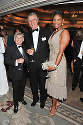 Left to right, WILLIE CARSON, ARNAUD BAMBERGER and DENISE LEWIS at the 22nd Cartier Racing Awards held at The Dorchester, Park Lane, London on 13th November 2012.