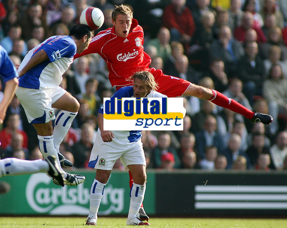 Photo: Paul Thomas.<br /> Liverpool v Blackburn Rovers. The Barclays Premiership. 14/10/2006.<br /> <br /> Peter Crouch (Red) of Liverpool tries to win the ball from Blackburn pair Zurab Khizanishvili (L) and Tugay.