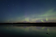Northern Lights light up the horizon as the Big Dipper stands above.