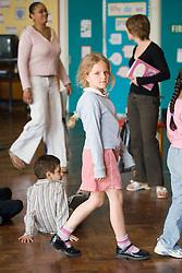 Children and teachers in school classroom,