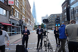 June 4, 2017 - London, England, United Kingdom - Journalists around London Bridge on June 4 2017 in London, UK. Police continue to cordon off an area after responding to terrorist attacks on London Bridge and Borough Market where 6 people were killed and at least 48 injured last night. Three attackers were shot dead by armed police. (Credit Image: © Jay Shaw Baker/NurPhoto via ZUMA Press)