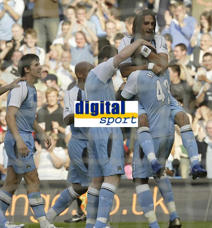 Photo: Aidan Ellis.<br /> Manchester City v West Ham United. The Barclays Premiership. 23/09/2006.<br /> City's Georguos Samaras leads the celebrations (top) after his goal