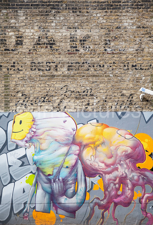 In this street in Camberwell in South London, a wall which shows the historic remains of an old advertising sign is contrasted by some modern graffiti street art. This contrast of old and new, young and old is a strong illustration of how times have changed in community and society.